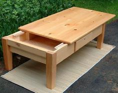 freshly constructed DIY coffee table with concealed compartment for gun satorage